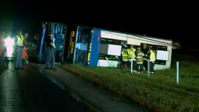 Rescue crews work on a Megabus in the median of I-65 near Greenwood. This image is taken from a video.