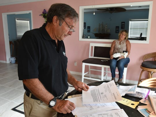 """We're clogging up the courts with something stupid like this, especially when it's a good thing, it just makes no sense to me,"" said pet owner David Daniels on Friday, April 14, 2017, while at his home in the Vero Beach Highlands neighborhood. Daniels has legal paperwork pertaining to charges related to his having a feral cat sterilized, vaccinated, microchipped and released back on to the streets. His neighbor, Sandy Murphy, holds one of the former feral cats he also had sterilized, that she has since adopted."