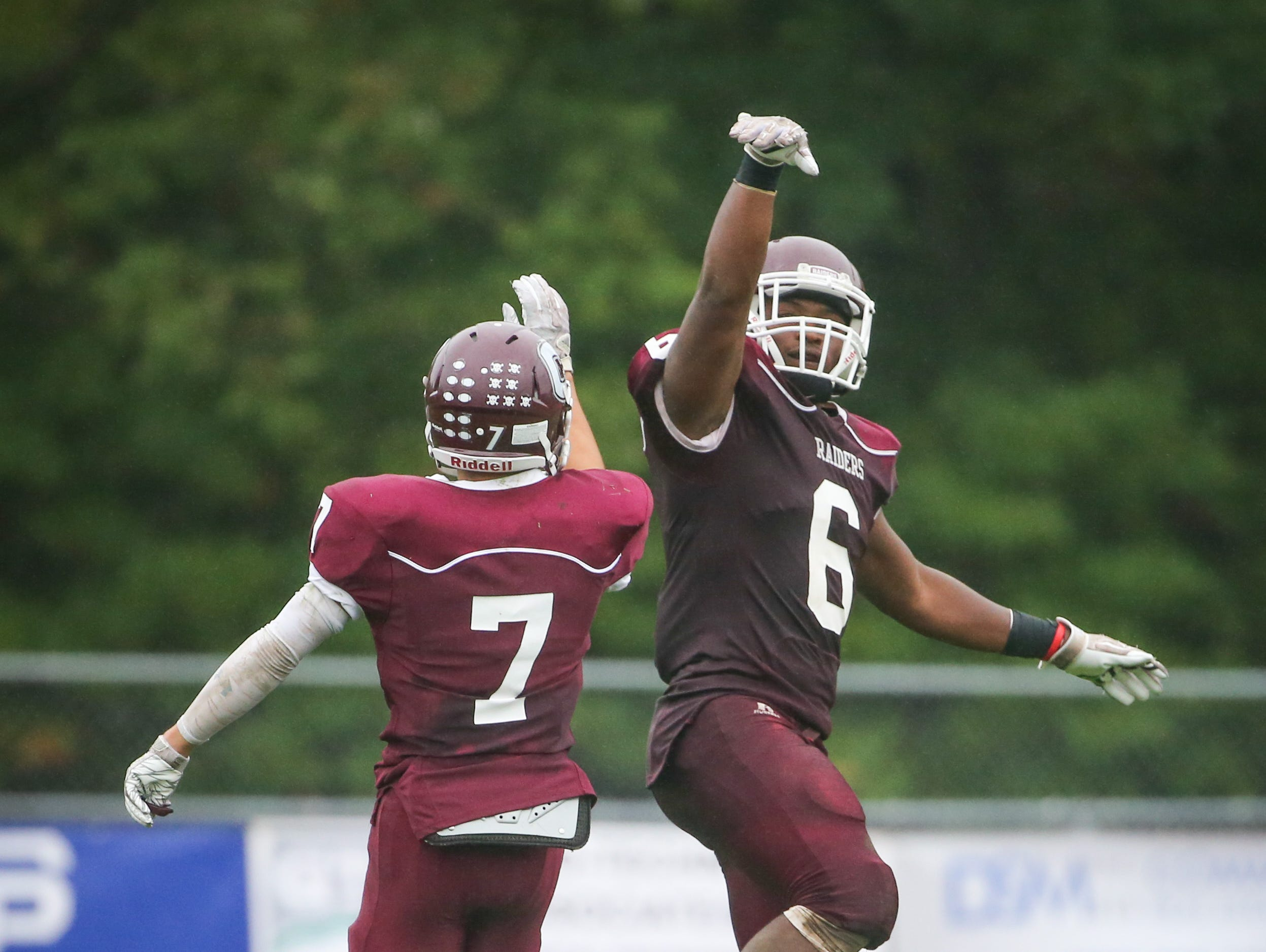 Concord's Grahm Roberts, No. 6, celebrates a 39-yard touchdown run with Luis Echevarria. Concord defeats Appoquinimink 30-0 at Concord Saturday.