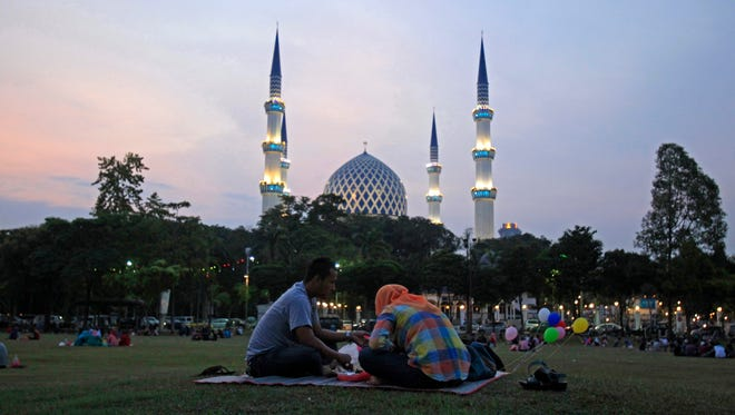 Muslims in Shah Alam, Malaysia, eat during Iftar - the sunset meal when Muslims break their fast in the holy month of Ramadan.