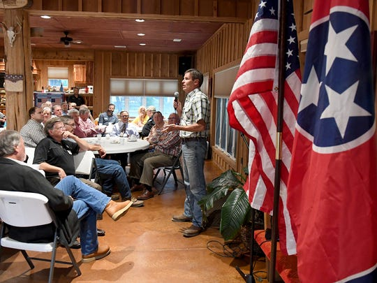 Republican gubernatorial candidate Bill Lee speaks to about 50 people in Madison County during a stop on his tractor tour across the state Oct. 10, 2017.