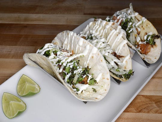 Pork belly tacos are one of the sharable plates on