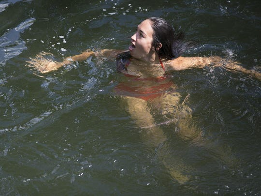 Ahni Lee of Denver, a Pittsford native, in Oatka Creek on Thursday in Canawaugus Park in Scottsville.