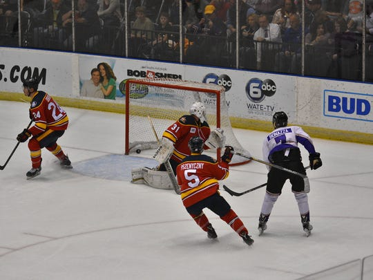 Ice Bears left wing Andrew Bonazza scores a goal during Friday's game with Peoria at Civic Coliseum.