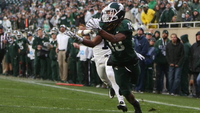 Michigan State's Felton Davis III makes a touchdown catch against Penn State's Christian Campbell during the second quarter on Saturday at Spartan Stadium in East Lansing.