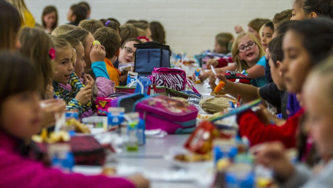 Students eat lunch at East Elementary in Cedar City. Programs are in place to make sure no child goes without a meal now that school is out for the summer.