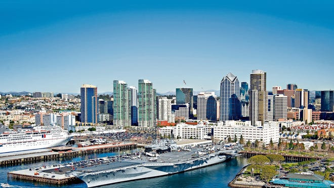 USS Midway Museum (center foreground) docked at Navy Pier in downtown San Diego.