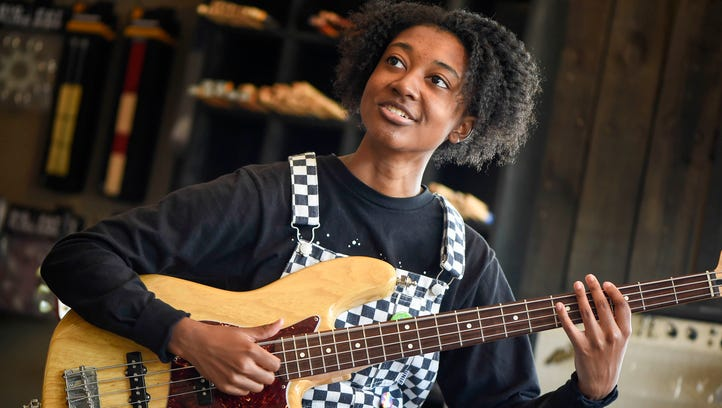 Guitarist Melanie Faye checks out bases and guitars