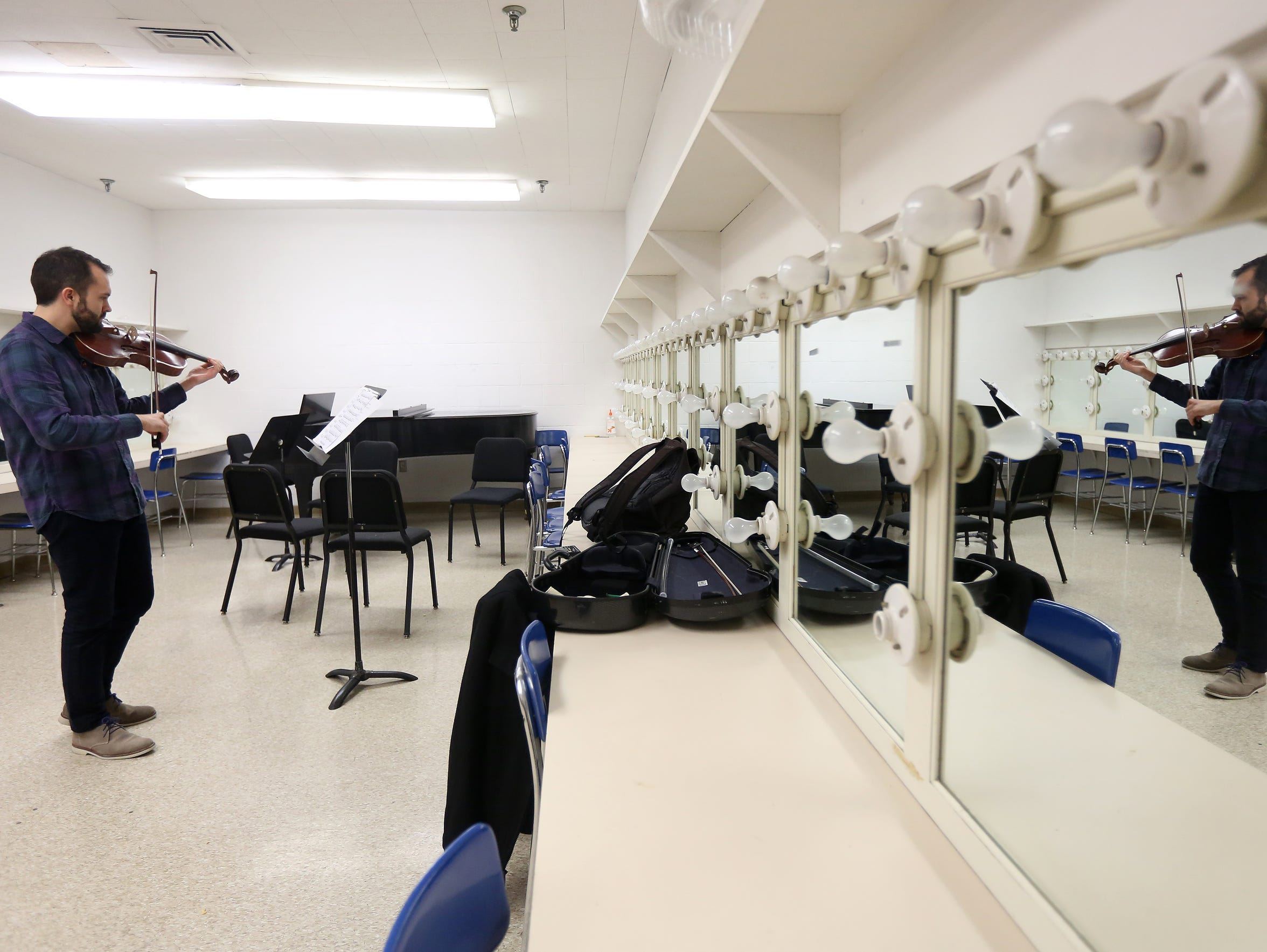 Goist practices in the dressing room of Music Hall
