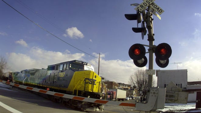 A file photo of a CSX freight train crossing through North Main Street in the village of Fairport.