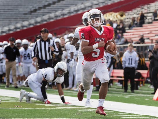 Manalapan's Naim Mayfield (No. 5) runs into end zone on a 34-yard burst for their first touchdown against South Brunswick in the NJSIAA Central Group V final .