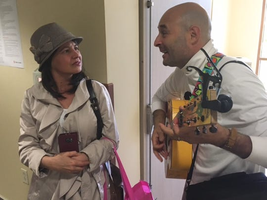 Cancer survivor Charlie Lustman tours the country singing about his fight with the disease. Here, he entertains Cleide Morris at St. John's in Oxnard after she received a radiation treatment.