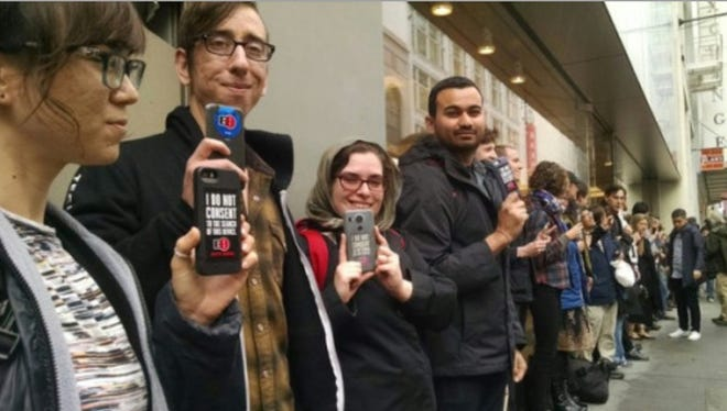 Apple supporters rally at the downtown San Francisco Apple store on Feb. 17 2016 to support the company in its refusal to aid the FBI in breaking into a phone owned by Syed Farook, one of the shooters in the San Bernardino mass shooting in 2015.