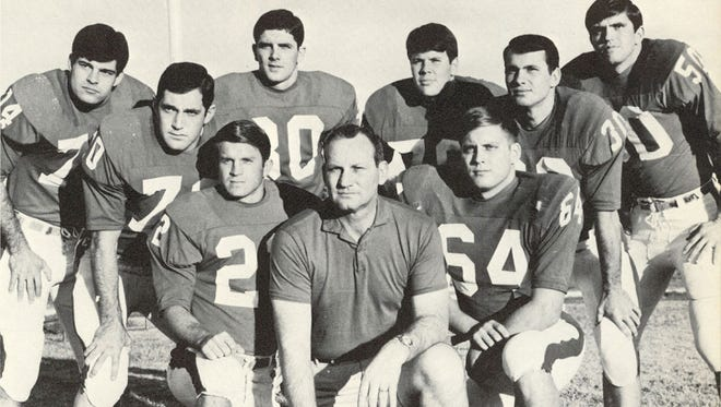 Mike Neustrom and the 1968 football seniors with Coach Russ Faulkinberry.