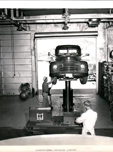"""It's cool inside the """"desertland service shop"""" at International Harvester Company's Phoenix Proving Ground, although the sun outside in blinding and the temperature stands at 110 degrees."""
