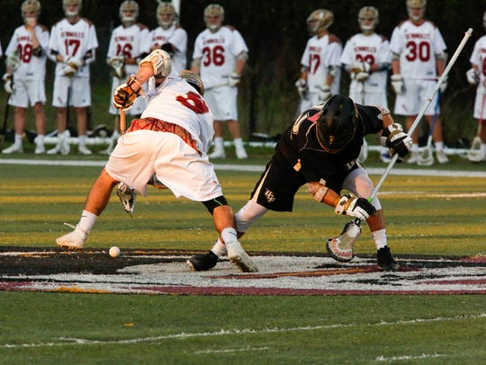 Dylan Lowedermilk (9) faces off for Florida State during