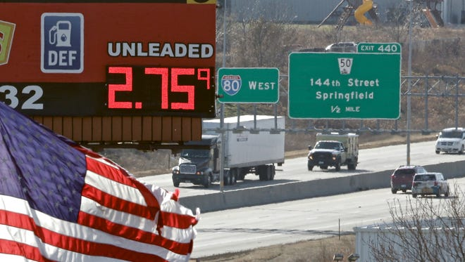 A sign advertises the price of gas to drivers on Interstate 80 in Omaha.