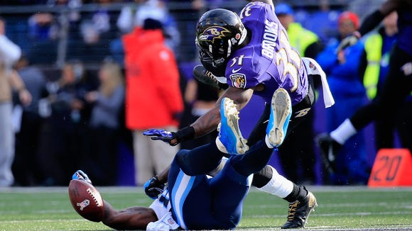 Ravens safety Terrence Brooks hits Titans tight end Delanie Walker during Sunday's game at Baltimore. Walker suffered a concussion.