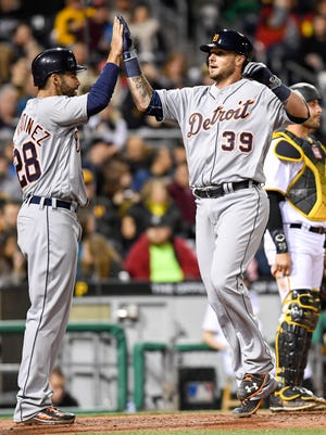Jarrod Saltalamacchia #39 celebrates with J.D. Martinez #28 of the Detroit Tigers after hitting a grand slam home run in the sixth inning during the game against the Pittsburgh Pirates at PNC Park on April 13, 2016 in Pittsburgh, Pennsylvania.