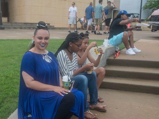 Singer Tatyana Webb, left,  eats frozen treats with