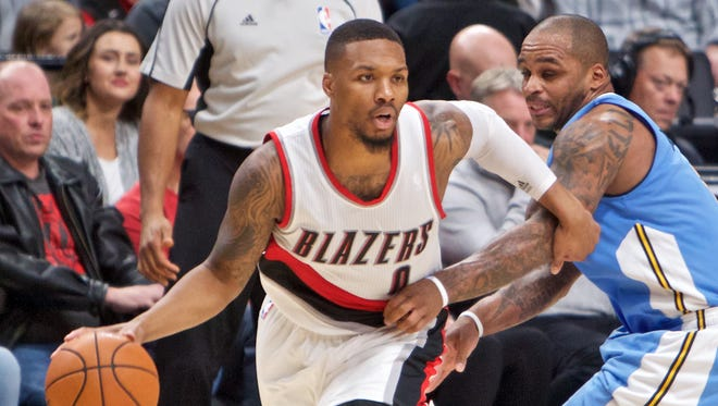 Damian Lillard (0) and the Blazers are headed to the playoffs at the expense of Jameer Nelson (1) and the Nuggets.