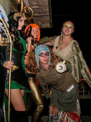 The winners in the cosplay contest at the Fish House during the 2018 Pensacon kickoff party on Thursday, Feb. 22, 2018. Left to right: first place, second place, and honorable mention; front: third place.
