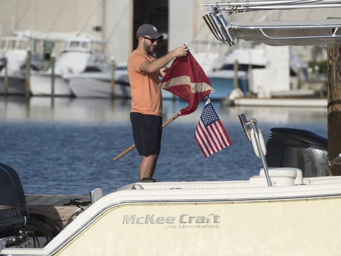 Matt Schallmo of Port St. Lucie readies his dive flag Wednesday, the opening day of lobster mini-season at the Sandsprit Park Boat Ramp in Stuart.