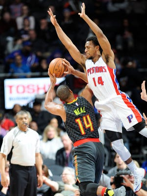 Pistons' Ish Smith fouls the Hawks' Gary Neal in the fourth quarter.