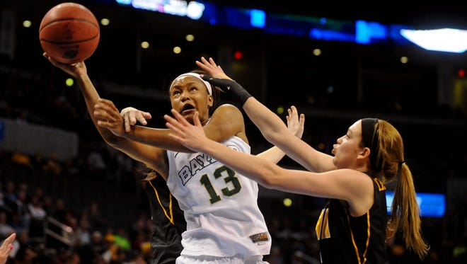 Baylor Bears forward Nina Davis (13) attempts a shot against Iowa Hawkeyes center Bethany Doolittle (51) and Iowa Hawkeyes guard Samantha Logic (22) during the first half  in the semifinals of the Oklahoma City regional of the women's 2015 NCAA Tournament at Chesapeake Energy Arena.