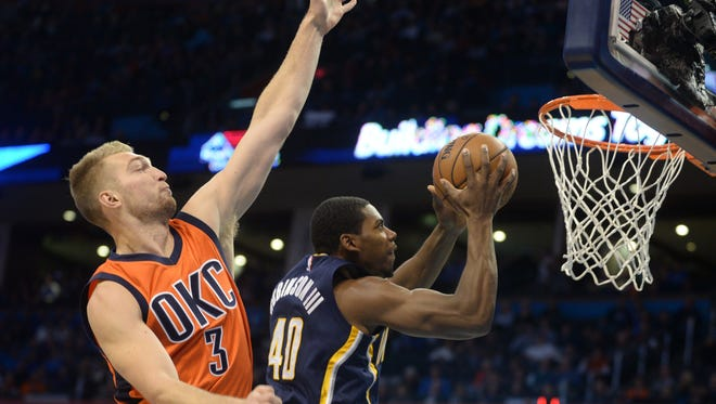Indiana Pacers guard Glenn Robinson III (40) shoots the ball in front of Oklahoma City Thunder forward Domantas Sabonis (3) during the first quarter at Chesapeake Energy Arena.