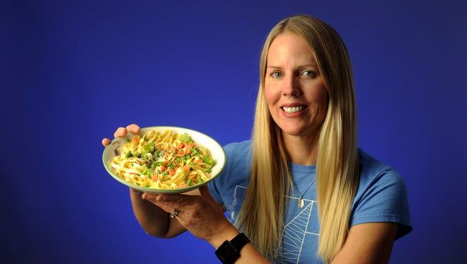 Cook du jour Jennifer Susan Jones shows off her dish of Emotional Pasta.