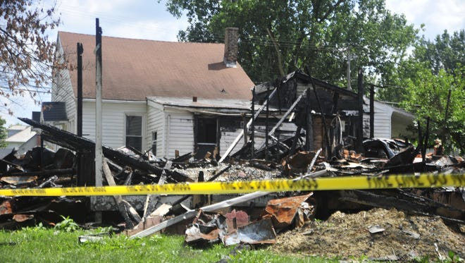 Burned houses in the 300 block of Warren Street will eventually be torn down, Bucyrus officials learned Tuesday.