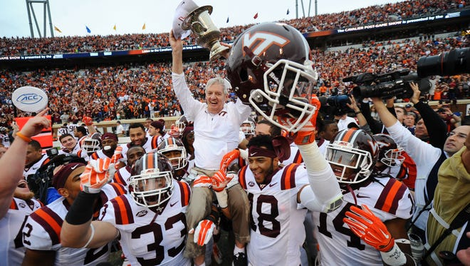 Virginia Tech coach Frank Beamer is carried by his players after beating Virginia in 2015.