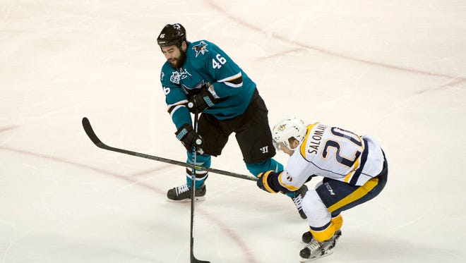 San Jose Sharks defenseman Roman Polak (46) passes the puck against Nashville Predators left wing Miikka Salomaki (20) during the third period in game five of the second round of the 2016 Stanley Cup Playoffs at SAP Center at San Jose.