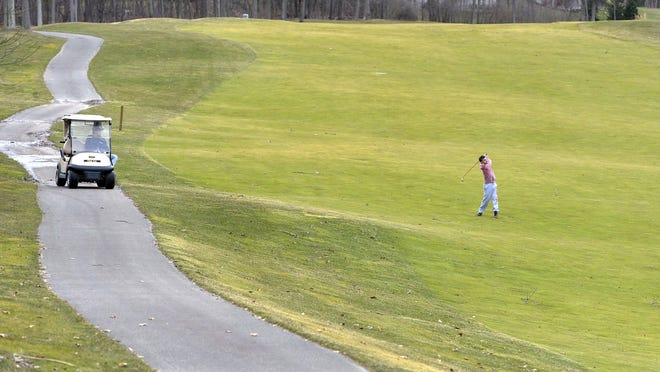 Quinn Lewis, 22, plays Whispering Woods Golf Club with friends in Millcreek Township on March 13. As the local golf season begins, Whispering Woods and other area golf courses, both public and private, are battling a nationwide decline in golfing.