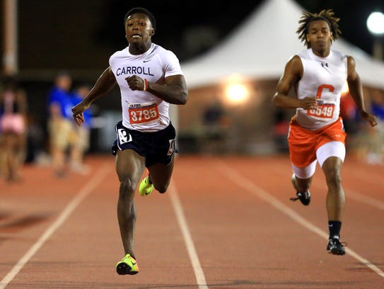 Carroll's Darian Thompson competes in the 5A boys 200