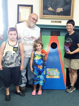 Sage Young, 6, of Annville (center) won the Lawn Games Prize Package from the GO! program. With her are (from left), her brother, Zane; her father, Vic; Cindy Funck, Annville Free Library children's librarian; and Melanie Wells, WellSpan Good Samaritan Hospital community health and wellness coordinator.