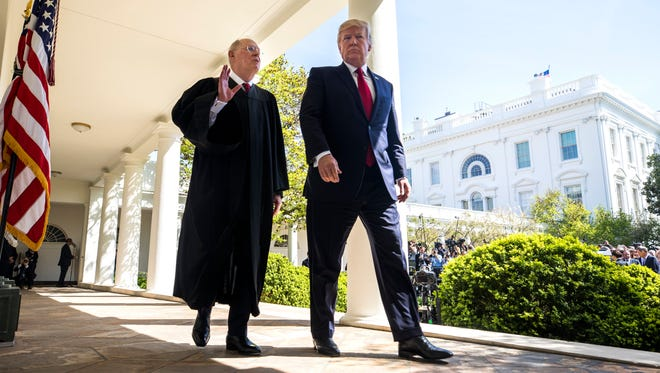 Supreme Court Justice Anthony Kennedy walked outside the White House with President Trump in April of last year, when Justice Neil Gorsuch took the oath of office.