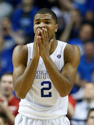 Kentucky guard Aaron Harrison and the rest of the Wildcats are the favorites to win it all - but not by the predictions of Couch, Rexrode and Solari.