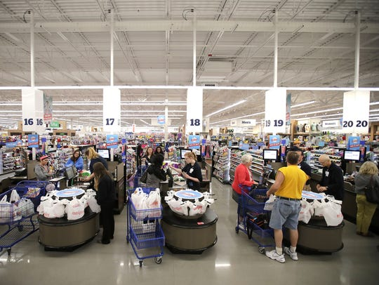 Customers check out on the first day Meijer is open in Grand Chute.