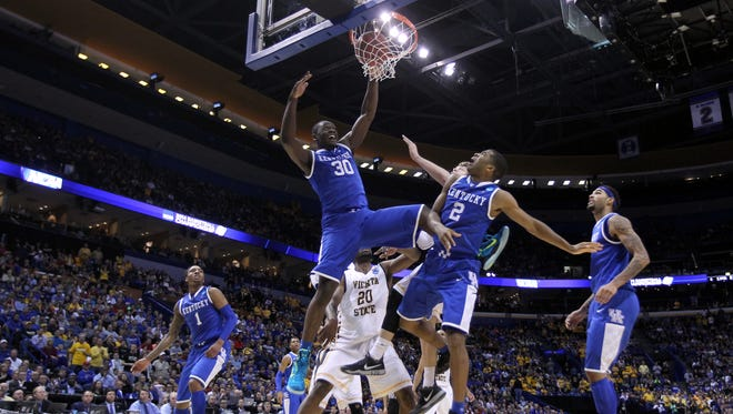 ST LOUIS, MO - MARCH 23:  Julius Randle #30 of the Kentucky Wildcats dunks the ball against the Wichita State Shockers during the third round of the 2014 NCAA Men's Basketball Tournament at Scottrade Center on March 23, 2014 in St Louis, Missouri.  (Photo by Andy Lyons/Getty Images)