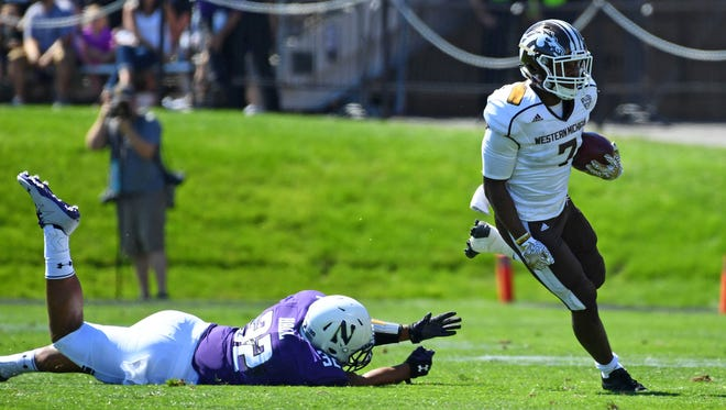Western Michigan Broncos wide receiver D'Wayne Eskridge (7) runs after a catch against Northwestern Wildcats defensive lineman Fred Wyatt (92) during the first quarter at Ryan Field.