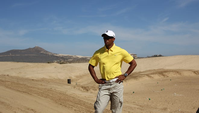 Tiger Woods is shown on the land prior to building his first golf course. He played on that course,  El Cardonal, at Diamante in Cabo San Lucas, Mexico, on Tuesday.