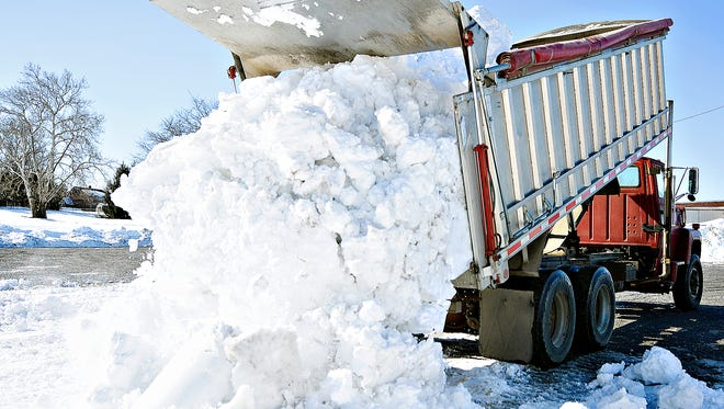 Alan Graser of All Season Lawn & Landscaping, dumps a truck load of snow, taken from East King Street, at Johnson Controls in York, Pa. on Wednesday, Jan. 27, 2016. (Dawn J. Sagert - The York Dispatch)