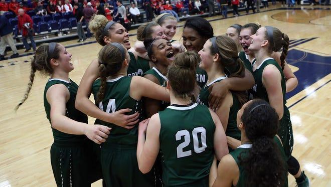 Mason players celebrate after defeating Lakota West. Mason defeated Lakota West 54-51 and will advance to the final four.