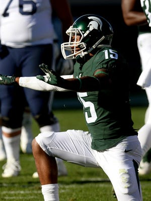 "Michigan State University sophomore cornerback Tyson Smith (15) signals ""no catch"" after a pass breakup in the first half of MSU's game against BYU Saturday, October 8, 2016 in East Lansing."