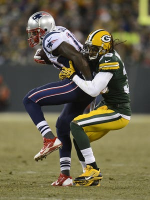 Green Bay Packers cornerback Tramon Williams (38) tackles New England Patriots receiver Brandon LaFell (19)  in the third quarter during Sunday's game at Lambeau Field. Evan Siegle/Press-Gazette Media