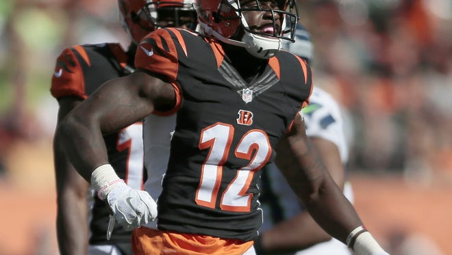 Cincinnati Bengals wide receiver Mohamed Sanu (12) celebrates a big gain on a reception in the fourth quarter of the NFL Week 5 game between the Cincinnati Bengals and the Seattle Seahawks at Paul Brown Stadium in Cincinnati, on Sunday, Oct. 11, 2015. The Bengals advanced to 5-0 with a 27-24 overtime win over Seattle.