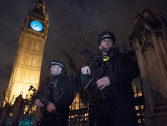 Armed police officers stand outside of The Queen Elizabeth