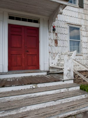 The need for repair is obvious outside the Burrowes Mansion on Main St. in Matawan